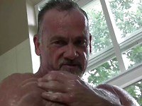 Hairy muscle daddy Mickie Collins jacking off dick