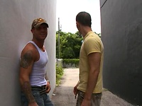 Two muscle hunks fu on a roof top