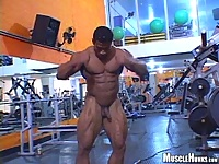 Brazilian bodybuilder Robert Bueno posing naked ina gym