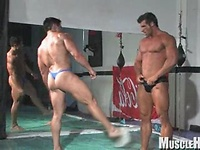 Bodybuilders wrestling
