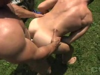 Guys with big muscles sucking their hard dicks under the sun