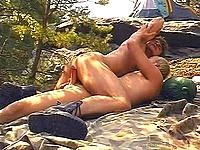 Hunky campers romping next to tent